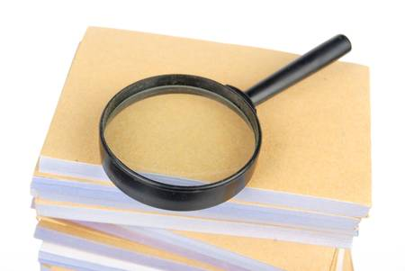 Documents and magnifier photo