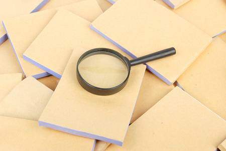 Documents and magnifier Stock Photo - 13137405
