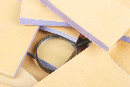 Documents and magnifier Stock Photo - 13137403