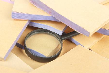 Documents and magnifier Stock Photo - 13137408