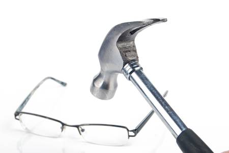 Eyeglass and hammer photo