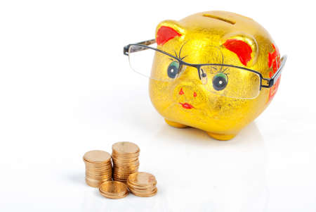 Piggy bank and glasses with coins Stock Photo - 13185978