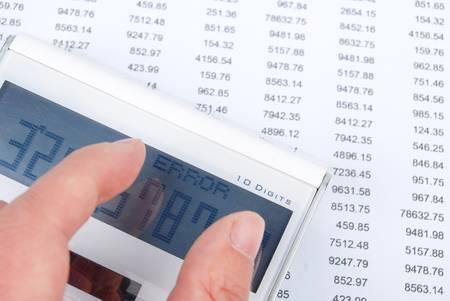 Financial data and calculator Stock Photo - 13236482