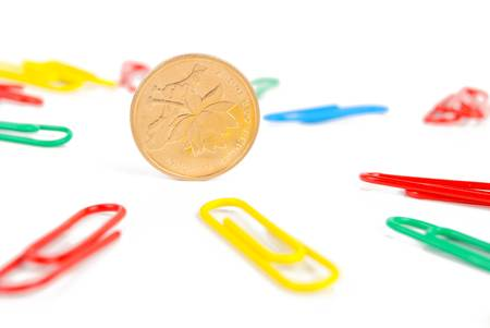 Paper clips and coin Stock Photo - 13235574