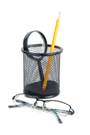 Eyeglasses and brush pot photo