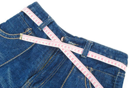 Measure tape and jeans photo