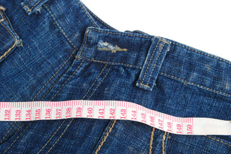 Measure tape and jeans Stock Photo - 13263792
