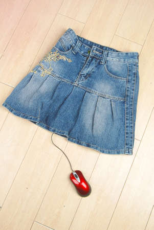 Jean skirt and computer mouse Stock Photo