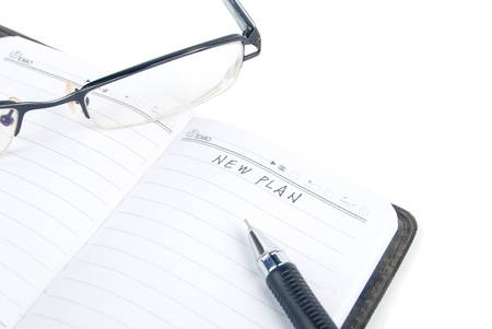 Notepad and glasses photo