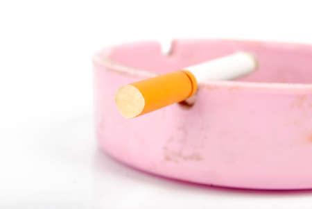 Cigarette in ashtray photo