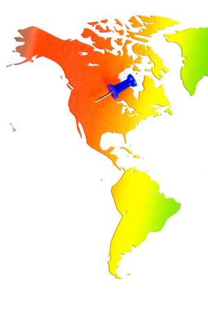 Push pin and world map photo