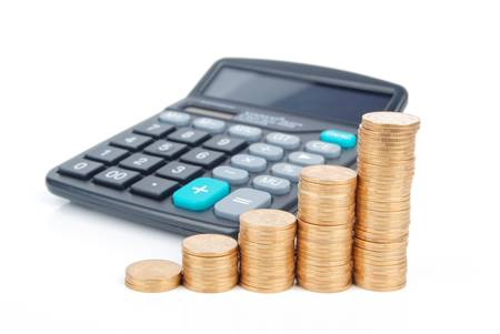 Calculator and coins Stock Photo - 13305284