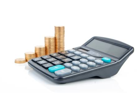 Calculator and coins Stock Photo - 13305392