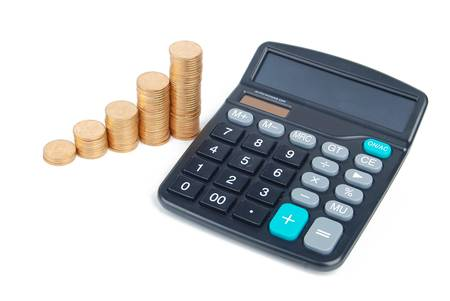 Calculator and coins Stock Photo - 13305275