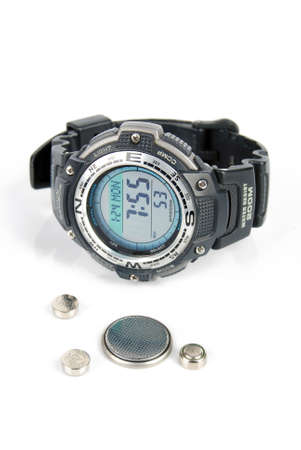Button battery and wrist watch Stock Photo - 13295693