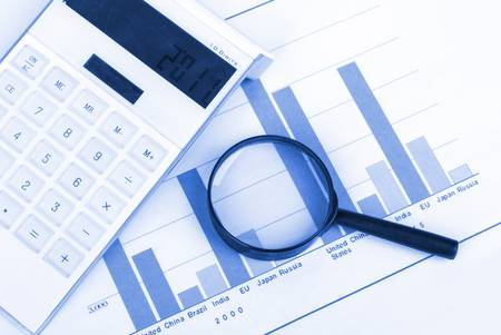 Magnifier and calculator with trend graph photo