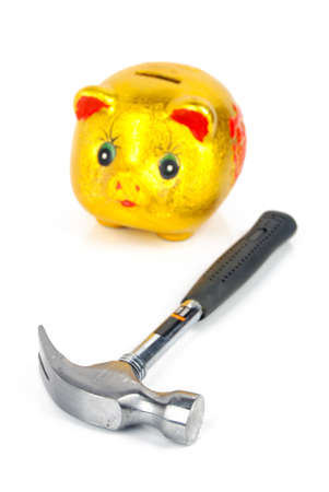 Hammer and piggy bank photo