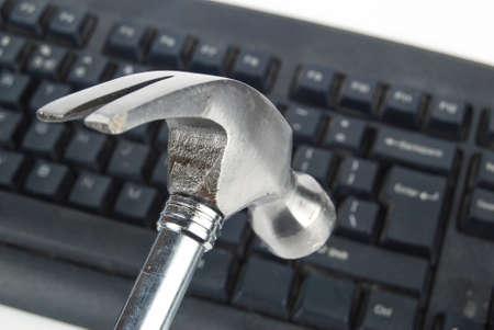 Hammer and keyboard Stock Photo - 13371638