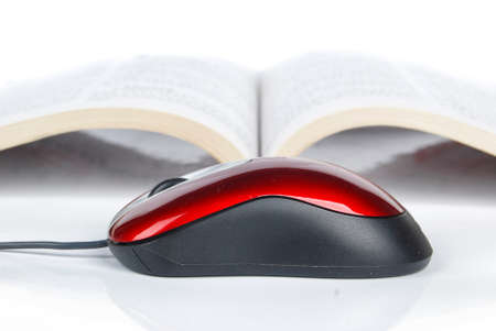 Computer mouse and book photo