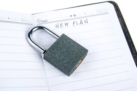 Padlock and notepad Stock Photo - 13446404