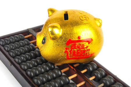 Piggy bank and abacus photo