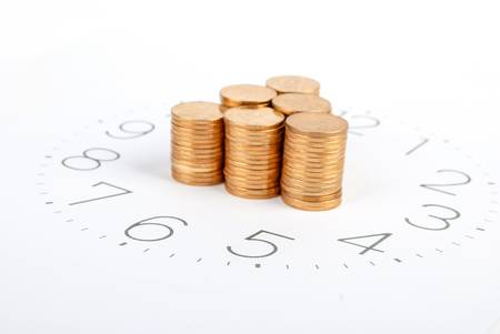 timely: Clock face and coin Stock Photo