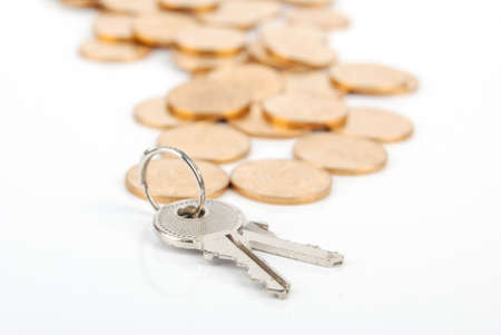 Key and coins Stock Photo - 13542708