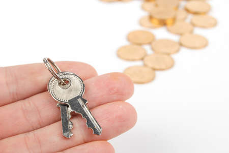 Key and coins Stock Photo - 13542734