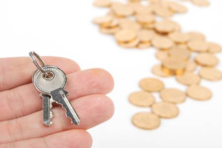 Key and coins Stock Photo - 13497157