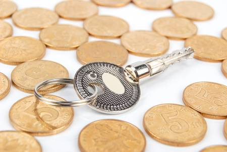 mortgaging: Coins and key