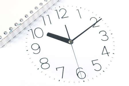 Notebook and clock photo