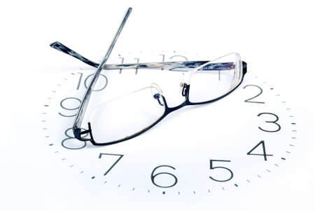 Eyeglasses and clock photo