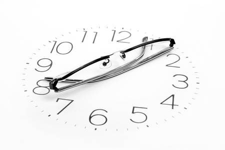 Eyeglasses and clock Stock Photo - 13447225