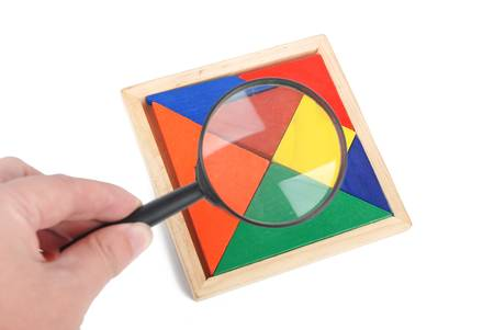 Tangram and magnifying glass photo