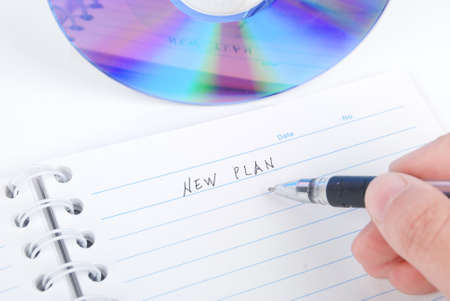 DVD and notepad with pen photo