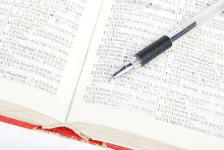 Pen and dictionary photo
