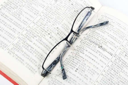 Eyeglasses and dictionary Stock Photo - 13460224