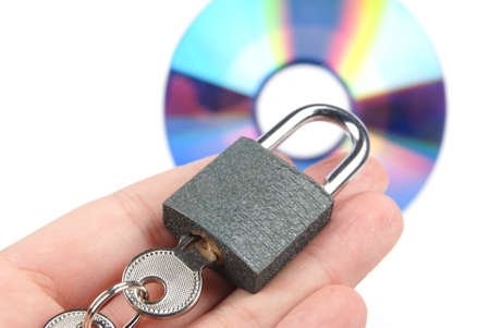 DVD and padlock Stock Photo - 13458094