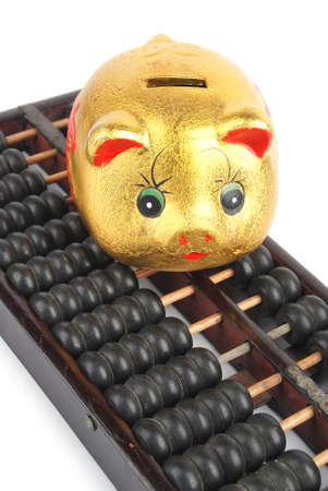 Piggy bank and chinese abacus photo