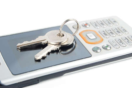 Mobile phone and key Stock Photo - 13488126