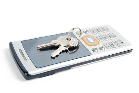 Mobile phone and key Stock Photo - 13479725