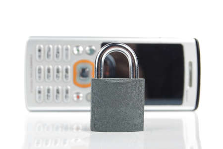 Mobilephone and padlock Stock Photo - 13488327