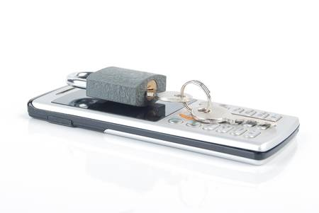 Mobilephone and padlock Stock Photo - 13479682