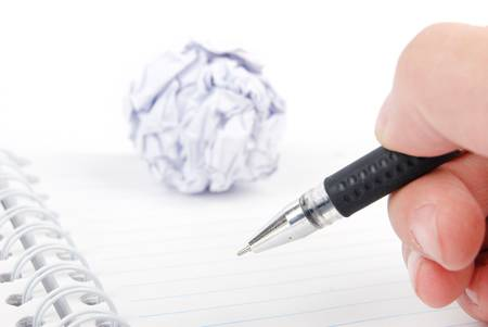 Crumpled paper ball and notepad with pen Stock Photo - 13492401