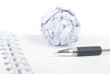 Crumpled paper ball and notepad with pen Stock Photo - 13492435
