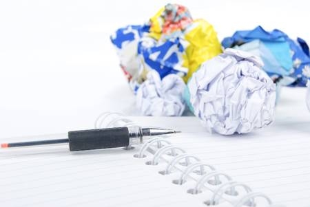crumpled paper ball: Crumpled paper ball and notepad with pen Stock Photo