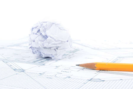 Crumpled paper ball and pencil with blueprint photo