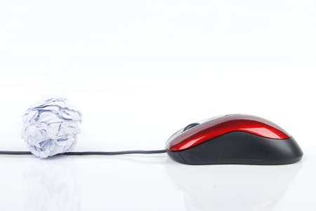 Crumpled paper ball and computer mouse photo