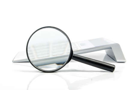 Magnifier with calculator Stock Photo - 13518710