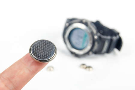 lithium: Lithium battery with digital watch Stock Photo